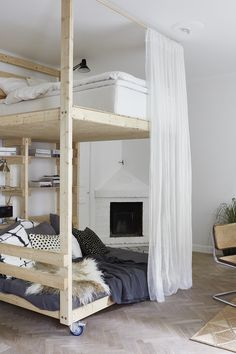 DIY loft bed with lounge space underneath. It's on wheels so easily moved