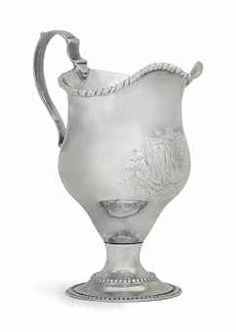 A SILVER CREAM JUG MADE FOR MOSES MICHAEL HAYS -  MARK OF PAUL REVERE JR., BOSTON, 1783 -  Of inverted pear form, on circular foot with beaded borders, with gadrooned rim and double scroll handle, engraved beneath the spout with monogram MRH within foliate surround, marked near rim, also marked under base with accession number 734.1973  5 ¼ in. (13.1 cm.) high; 5 oz. (165 gr.)