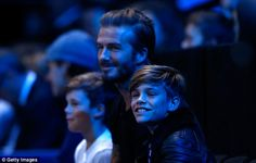 Family man: David Beckham treated his two boys Cruz (left) and Romeo (right) to theBarclays ATP World Tennis Finals in London on Saturday
