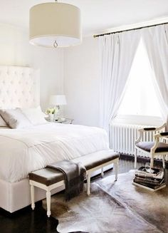 The grand, white bedroom