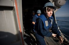 Information Systems Technician 3rd Class Lauren Puente heaves a line during a replenishment-at-sea aboard the guided-missile destroyer USS Stockdale (DDG 106). Stockdale is deployed to the U.S. 5th Fleet area of responsibility promoting maritime security operations, theater security cooperation efforts and support missions for Operation Enduring Freedom. (U.S. Navy photo by Mass Communication Specialist 2nd Class David Hooper/Released)