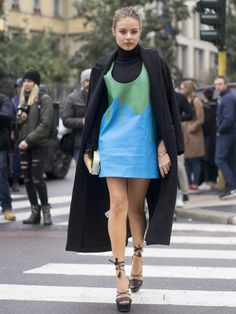 Pin for Later: 50 Styling Lessons to Steal From Fashion Month's Best Dressed Tame a minidress with a poloneck underneath.