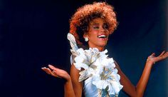 You can't #celebratesparkle without this iconic image of Whitney Houston. Those curls, that smile...that dress. #stunning