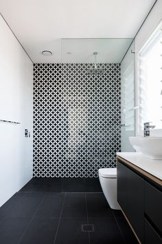 Black and white bathroom design with statement tiles in Davidson NSW. Design by Hobbs Jamieson Architecture Black Tile Bathrooms, Black And White Tiles Bathroom, Big Bathrooms, Black Tiles, Bathroom Feature Wall Tile, Diy Bathroom Decor, Bathroom Interior Design, Minimalist Bathroom Design, Feature Tiles