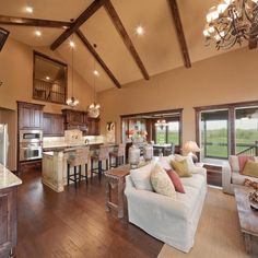 Open concept kitchen living dining great room for Hearth room furniture layout ideas