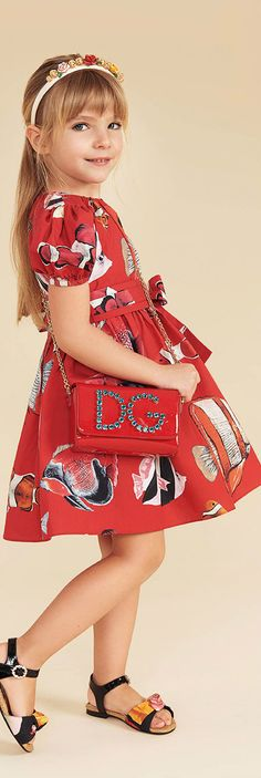 Dolce & Gabbana Girls Mini Me Red Clown Fish Silk Runway Dress for Spring Summer 2018. Love this delightfully pretty mini me look inspired by the D&G Women's Collection.. Perfect Special Occasion Summer Party dress for a little princess at the beach or on vacation. Pretty Summer Look for a stylish kid, tween and teen girls. #dolcegabbana #girlsclothing #kidsfashion #fashionkids #girlsdresses #childrensclothing #girlsclothes #girlsfashion
