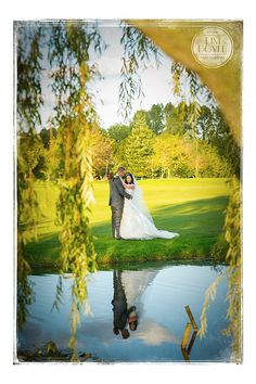 Dunston Hall Weddings - Norfolk Wedding Photographer - Tim Doyle Photography - Bride and groom's reflection in lake