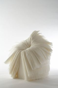 Cabbage chair, which is made of a roll of pleated paper that is a byproduct in clothing production.