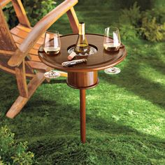 Whether youre relaxing out in the backyard with a bottle of wine, having a picnic in the great outdoors, chilling at the beach, or just having a festive outdoor party, these cool new Staked Mahogany Lawn Tables are the perfect thing. These portable mahogany wine tables securely spike into the ground, have a wood-covered metal-lined bottle cooler in the center, and two slots for hanging stemware. For the Love of Wine http://www.pinterest.com/wineinajug/for-the-love-of-wine/