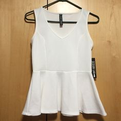 NWT Design Lab white peplum shirt Brand new with tags. Cute white peplum shirt from Lord and Taylor, the brand Design Lab Design Lab Tops Tank Tops