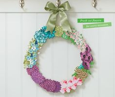 This gorgeous paper wreath has been created using the new Flower Market Cricut…