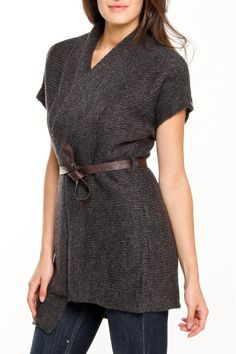 Dex is a true pioneer in affordable luxury. For work. For play. The latest runway looks have never been so affordable. Dex makes looking good effortless  Features knit construction  Open front  Self tie faux lather belt at waist  Dolman sleeves