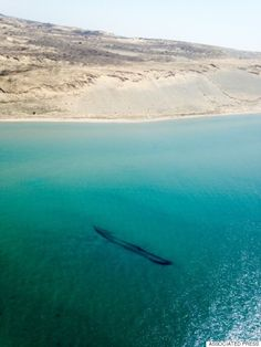 Lake Michigan shipwrecks revealed in clear blue waters this spring.