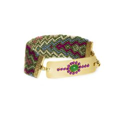 Love this! Found it on Lily's Boutique  Playful yet sophisticated, Adile is the friendship bracelet you can still pull off. Handwoven in the Philippines and adorned with jade and fuchsia sparkle and glam set on a gold plated charm, Adile will have all your friends asking where you got your bracelet.  - Woven cloth, gold metal, jade and fuchsia stones