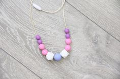 Nursing and Teething Silicone Necklace with white от TeetherLand