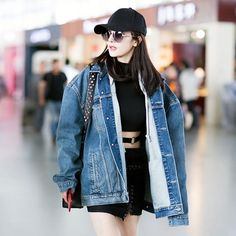 #SundayStreetStyle #Yangmi finds balance between rock chic and sportiness mix-matching oversized retro denim jacket and midriff baring getup. #周日街拍 #杨幂 用做旧丹宁夹克混搭露腹迷你裙套装在摇滚风与运动风中找到平衡  via VOGUE CHINA MAGAZINE OFFICIAL INSTAGRAM - Fashion Campaigns  Haute Couture  Advertising  Editorial Photography  Magazine Cover Designs  Supermodels  Runway Models