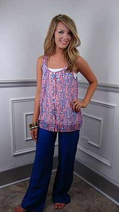 """This slightly sheer tank has a cute print with """"blots"""" of pink, blue and white all over. If has a button front style and tiny pleats, which provide a loose and flowy fit. Pair with our famous white cami and blue linen pants to complete the outfit!   $42"""