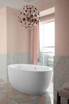 Stillness® bath filler   Sunstruck® bath     ANN SACKS® Carrara field tile     Set into a sunny alcove, a separate bathing nook invites calm respite with an oval, ergonomically designed bath.