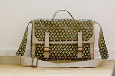 Make a leather and fabric paneled shoulder bag with this tutorial and free downloadable pattern.