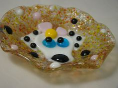 Fused glass catch all doggy  bowl by HighfireGirl on Etsy, these are small ruffle catch all bowls that you can use them tea light holders, guest soap bowls, candy bowls, hold your jewerly or rings in.  I love them