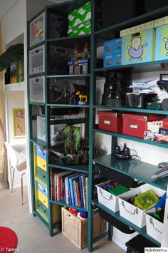 """Ikea Ivar used for storage in a childrens room; trapezoid """"bridging"""" shelves are used to visually join the wide units to the narrow units."""