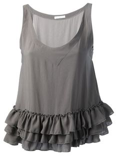 Taupe silk loose fit tank top from Société Anonyme featuring a scoop neck, a sleeveless design, an oversized fit and a ruched detail hem. This item is true to fit.