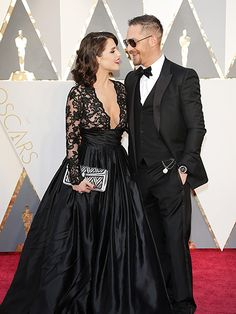 Best PDA, Coolest, Most Stylish: The Couples Superlatives at this Year's Oscars | BEST LOVING LOOKS | There are cameras all around Charlotte Riley and Tom Hardy – but they only have eyes for one another.