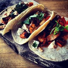 Roasted chicken and sweet potato tacos with queso fresco, salsa and caramelized onion marmalade.   Follow our visual delights on Instagram: http://web.stagram.com/n/foodrepublic/ Would leave out chicken to make veggie
