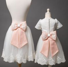 A classic piece. Very light pink ottoman silk dress with tulle on the bottom and inside the skirt part. Offered by Baby Shop Online - Itty Bitty Toes!