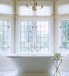 freestanding tub, sheer roman shades