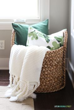 Pottery Barn Beachcomber basket with chunky ivory throw, green velvet and fig leaf pillow. Great tips for winter home maintenance! #ad