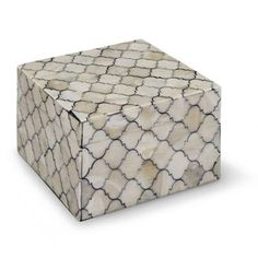 A patchwork of cream and black colored Kabibe shell in our Mosaic Quatrefoil Box enhances interior spaces. Store your treasures in this Moroccan styled    container.            Made of wood composite and resin                Cruelty-free cow horn construction                Onyx pieces applied to wood                Velvet lined                Wipe clean with a soft, damp cloth