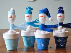 You won't have to worry about these snowmen melting! Simply turn leftover plastic spoons into tiny snowmen with pom-poms, tissue paper, a clay pot, and felt.  Get the tutorial at Crafts by Amanda.   - CountryLiving.com