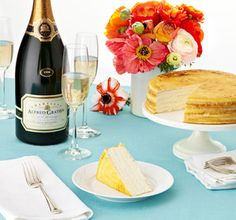 Crepe cake, Champagne, and a colorful arrangement of flowers