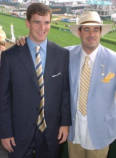 Pin for Later: Hats, Horses, and High Stakes — Stars at the Kentucky Derby!  In 2004, Eli Manning and Carson Daly suited up to watch the races.