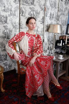 Oscar de la Renta dress, hand-embroidered turn-of-the-century jacket, Russian red leather ballet shoes with gold laces and coins, vintage embroidered clutch.