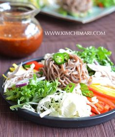 Cold Buckwheat Noodle Salad (막국수 Makguksu)  is a refreshing, cooling dish full of nutrients yet low in calories.  It is very tasty and so healthy for you.  Buckwheat cools the body and is a favorite summer noodle in Korea!  This spicy and sweet the dish helps us beat the heat.  | Kimchimari.com
