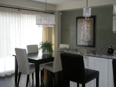 Accent kitchen wall done in a moss green venitian plaster.
