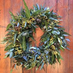 wreath - Mixed eucalyptus leaves were added along with gum nuts, yellow seed eucalyptus and yellow Kangaroo Paw.