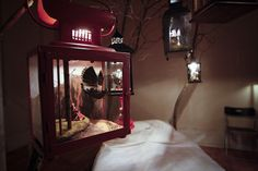 """CUTMR 2010 """"Can You Remember My Dream"""" by Julia Hepburn - a surreal bedroom scene featuring a little black bird, tucked snugly beneath the bedsheets and surrounded by floating dioramas of what she says are the dreams of birds."""