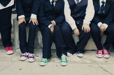 groomsmen wear the same color converse as the bridesmaid they're paired with