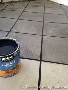 Tired of looking at your ugly garage floor? Want it to be a beautiful space just like the rest of your home?  Staining the floor is the answer! Check it out!  How to Pimp Your Garage Floor {On a Budget} - Farm Fresh Vintage Finds