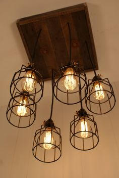 Cage Light Chandelier - Cage Lighting - Industrial Lighting - Edison Bulb - Upcycled Wood. $375.00, via Etsy.