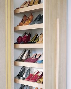 Normally utilized in kitchens, a pull-out pantry becomes a shoe closet when the shelves are installed at an angle; professional assistance is recommended for this project. Nonskid shelf liners prevent pairs from sliding when the unit moves.