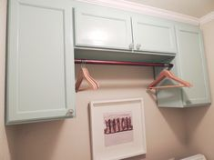 For a functional laundry room configuration, place a rod between two vertically long cabinets to create a hang-dry area for clothes above the washer/dryer above washer and dryer hanging clothes Laundry Room: Revealed Laundry Room Rugs, Laundry Room Design, Laundry In Bathroom, Room Design Bedroom, Small Room Bedroom, Laundry Room Cabinets, Kitchen Cabinets, Hanging Cabinet, Hanging Clothes
