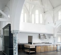 The high arched ceilings and classic pillars accentuate the dramatic space within which Rupert Bevan created the kitchen