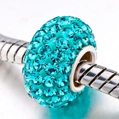$24.49 This Blue Topaz Color Crystal Bead is the perfect addition to your European style bead bracelet. Made from .925 Sterling Silver and sparkling iridescent blue topaz cubic zirconia crystals, the Blue Topaz Color Crystal Bead is compatible with Chamilia bracelets, and Chamilia charms! An exciting variety of available patterns will allow you to create your own stylish bead bracelet. Mix and match crystal beads, glass beads, birthstone beads...