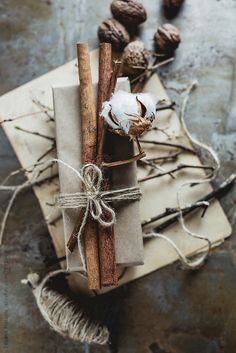 Gift with cinnamon and cotton on a rusty background