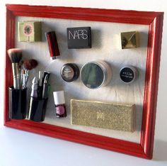 Oh my gosh.  It's a magnet board, and then you put magnets on your makeup, and - and - there it all is looking so pretty!!!  (note: this is probably best for makeup that won't wind up in your purse anytime soon, to demagnetize your credit cards, but I bet it's perfect for eyeshadows.)