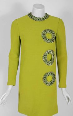 1967 Pierre Cardin Chartreuse Green Silk Cut-Out Beaded Circles Cocktail Dress | From a collection of rare vintage evening dresses and gowns at https://www.1stdibs.com/fashion/clothing/evening-dresses/